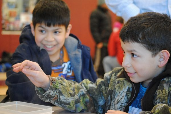 Students interact with memory metal at Family Science Night at Goodman Community Center in Madison, WI.